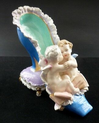 Beautiful Antique Porcelain Cherub  /putti Shoe Resting On A Cushion
