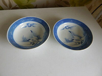 A pair of signed antique Japanese blue and white porcelain bowls