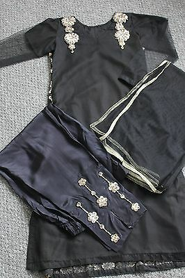 Black and gold net shalwar kameez (traditional outfit)
