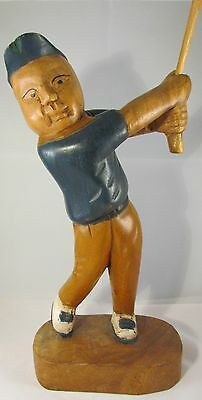 Wooden carved golfer
