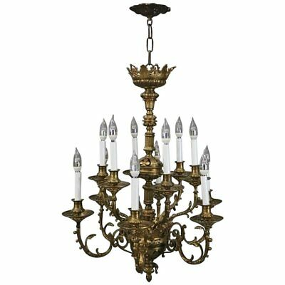 French Louis XV Scroll & Foliate Eleven-Light Bronze Chandelier, circa 1930