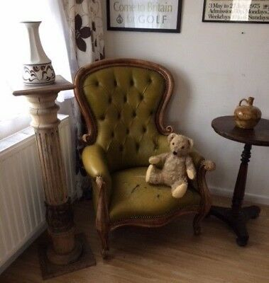 Deep buttoned back green leather library armchair. Open to offers