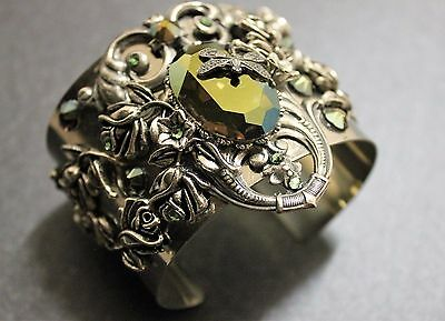 Victorian vintage style chunky cuff made with Iridescent green Swarovsk crystal