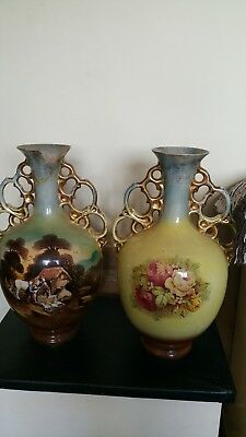 edwardian vases one has been damaged hence the price.