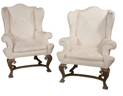 Pair of Georgian style mahogany wing chairs with arched backs, roll o... Lot 247