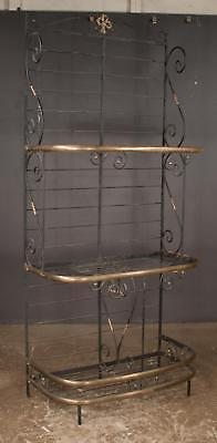 Three tier iron baker's rack with brass trim and scroll design on eac... Lot 357