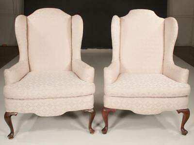 Pair of Queen Anne style wing chairs with arched backs, roll over arm... Lot 304