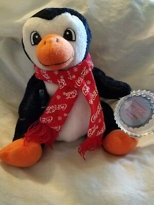 Coca Cola Beanie Baby collectable- penguin with scarf & pop tag in plastic case.