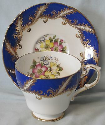 Paragon Cup & Saucer Floral Pattern white with Cobalt & Gold Trim Outside Cup