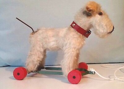 Vintage Fox Terrier Toy Pull Along on Wooden Wheels & articulated Tail  1930/40