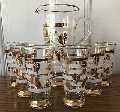 Vintage clear glass jug & 6 tall glasses with frosted panel & gold leaf pattern
