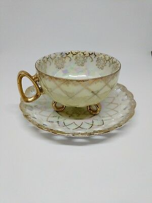 Footed Tea Cup And Saucer - Gold flower design inside and rim.  Tullip on rim.