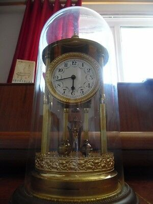 antique large decorative anniversary clock under glass dome