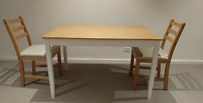 Ikea Lerhamn dining table and two chairs