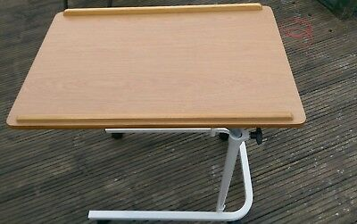 Ajustable over bed table