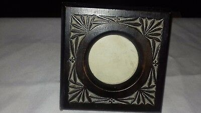 Arts and crafts era small hand carved photo frame with glass photo cover