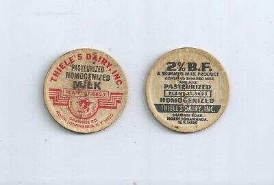 "Two different ""Thiele`s Dairy, Inc.""  North Tonawanda, N.Y.  milk bottle caps."