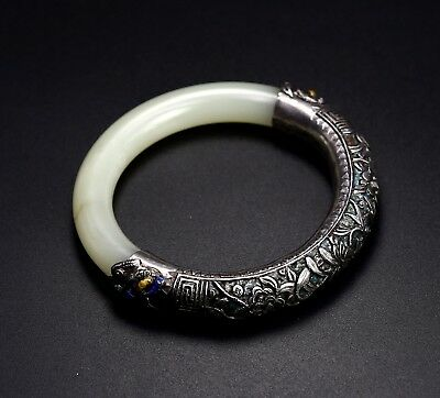 A Chinese Antique white jade bracelet with silvery