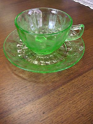 Green Depression Floral Poinsettia Cup and Saucer Set by Jeannette