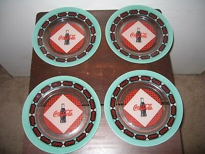 """4 Coca-Cola 10"""" Dinner Plates Black/Red/Green Pre-Owned MFG 1999"""