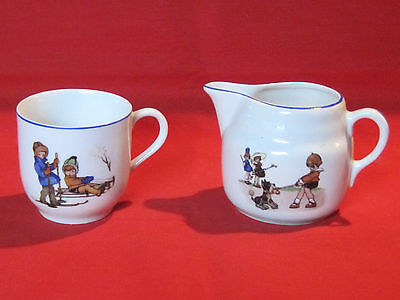 Vintage child's pitcher w/ dog playing croquet & cup w/ children on skis & sled