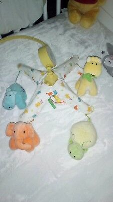 cot mobile from mothercare, very colourful Animals and a soft tune.