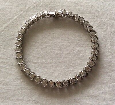 """Lovely silver and cubic zirconia tennis bracelet .Marked 925 .Lgth 7.5"""" V.G.C!"""