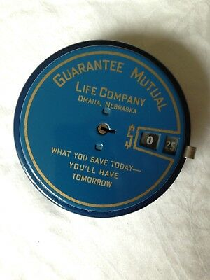 Guarantee Mutual Life Co., Omaha, mechanical coin bank.  Excellent condition.