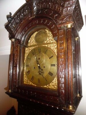 grandfather clock in an oak gothic case by  tho's reid montrose