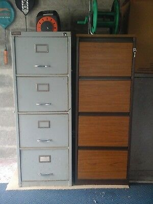 2 - 4 draw   filing cabinets   - one wood veneer finish .- one metal grey.used.