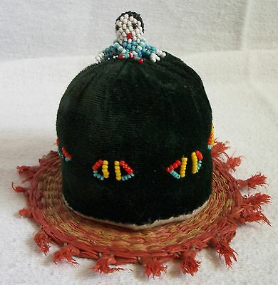 antique hand made pin cushion beaded lady and  raffia mat