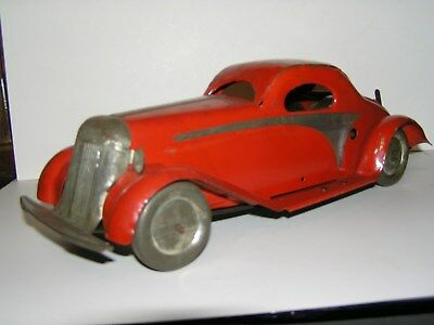 Vintage  Tin  Clockwork Red Coupe . Unknown Maker ( Well's ).?? 330 Mm. 1930's
