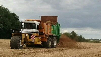Muck spreader terragator with clamshell loader and spare terragator