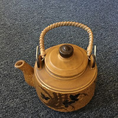 Ceramic Teapot With Birds Building Nest Design And A Woven Handle