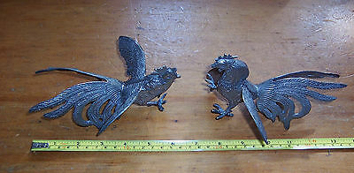 Vintage pair of white metal fighting cockerels both used