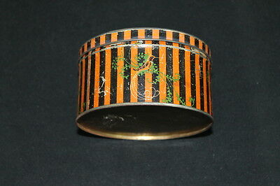 vintage orange & black face powder tin bird of paradise