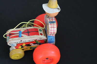 vintage Fisher Price farmer tractor pull toy