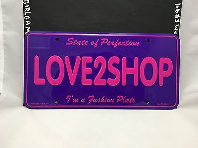"""Novelty State of Perfection """"Love2Shop"""" Car/Bar/Room Metal License Plate"""