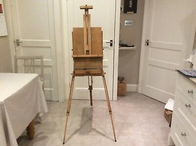 vintage wooden paint easel with paint tray and palette