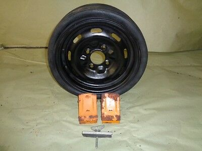 1979,80,81,82,83 Datsun 280zx OEM Space Saver Spare Tire/Wheel Chocks/Hold Down