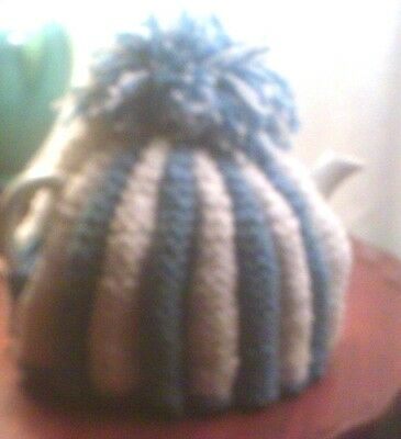 Hand-knitted blue and white tea cozy