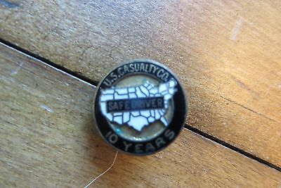 Old U.S. Casualty Insurance, 10 year safe driver button collar pin, advertising