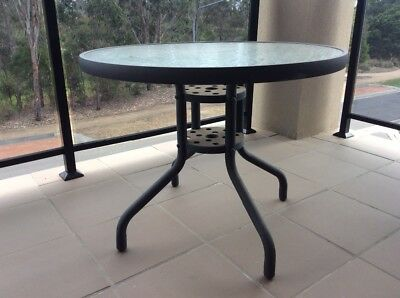 Round glass outdoor table