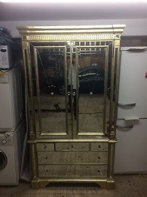 Armoir wardrobe. Large antiqued gold and mirrored glass with draws & hanging