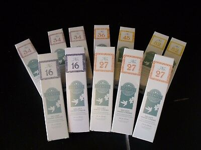 LOT OF 12 SCENTSY VELVET HAND CREAMS (2 oz. EACH) (NEW IN BOXES)