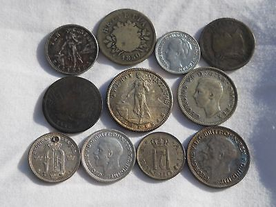 Twelve Old Silver Coins From Around The World