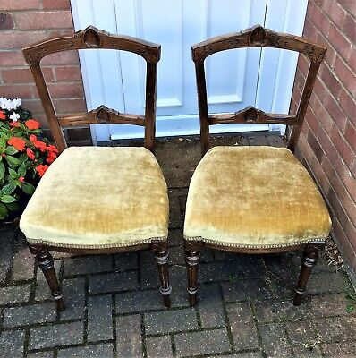 A Pair Of Edwardian Chairs With Over Stuffed Seats