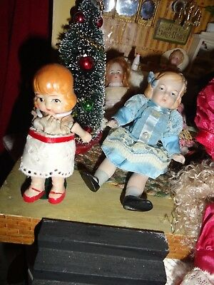 bisque dollhouse dolls  lot of 2