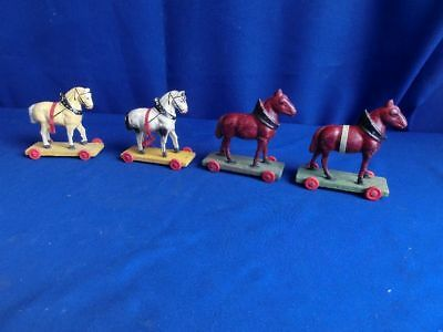 4  vintage  antique    small   paper  mache  and wooden  horses  pull toys