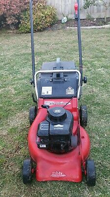 Rover push lawn mower 4 stroke engine 148cc (starts and runs great )